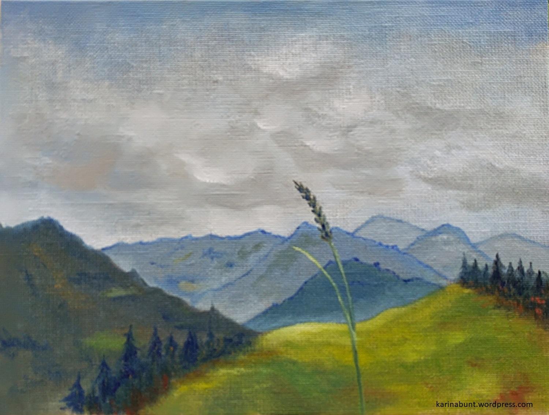 Ansicht von Bergen mit Grashalm im Vordergrund