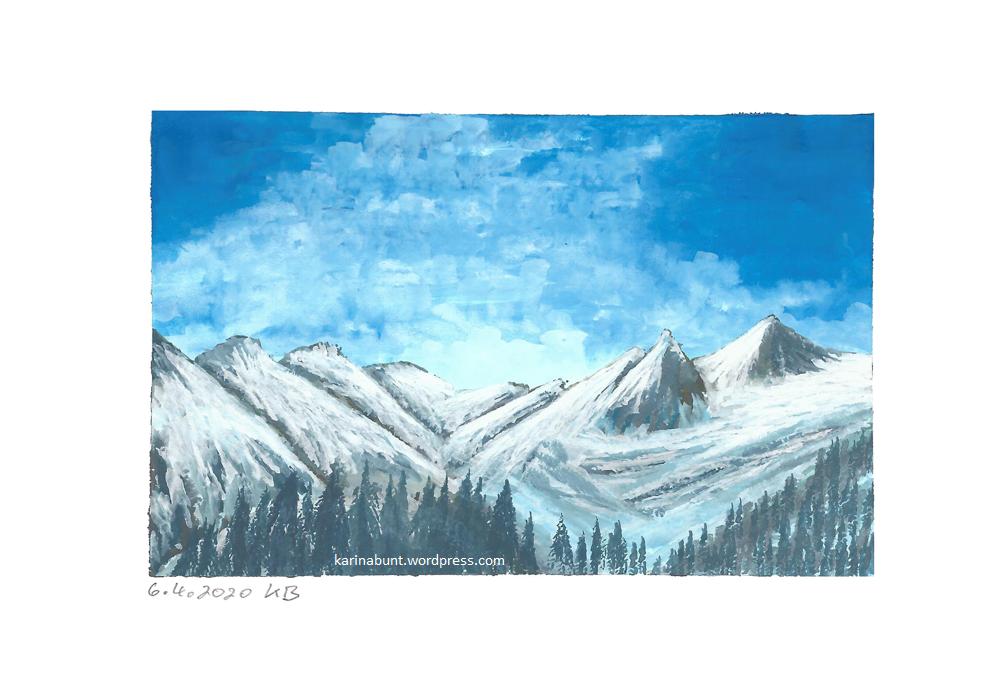 verschneite Berggipfel mit Nadelwald im Vordergrund